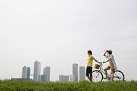 Young couple with bicycle (thumbnail)
