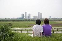 Couple looking at city skyline