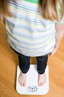Girl standing on scales