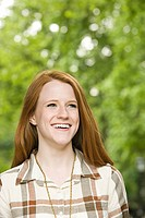 Smiling young woman with ginger hair