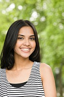 Smiling young mixed race woman