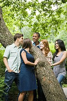 Five friends around a tree