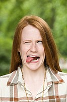 Ginger haired girl making faces