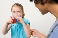 Girl taking asthma inhaler