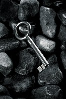black key on black pebblestone