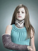 Girl with neck brace and arm in plaster