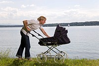 dad pushing baby in pram