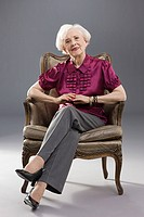 Portrait of a senior woman in a chair
