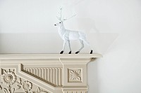 Reindeer figurine on mantlepiece