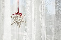 Snowflake decoration in window