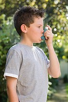 Boy taking asthma inhaler (thumbnail)