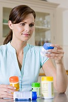Woman looking at vitamins