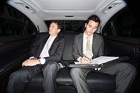 Businessmen in the back of a car