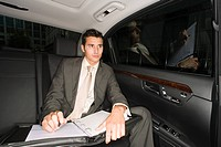 Businessman in the back of a car