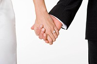 Newlywed couple holding hands (thumbnail)