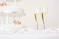 Champagne flutes and a wedding cake