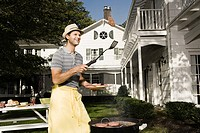 Man cooking on a barbecue