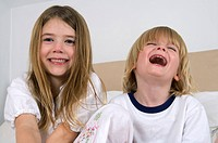 Young girl and boy laughing.