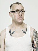Man with eyeglasses and tattoos