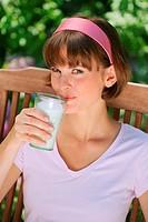 woman drinking milk, portrait