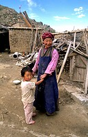 Tibetan with her child, China