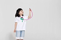 little girl holding stethoscope