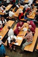 A drinker in a beer hall sleeps during the Oktoberfest beer festival in Munich in southern Germany