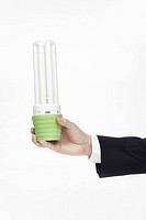 business man holding bulb light
