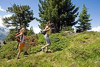 two women walking in the mountains