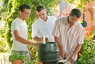 men with beer barrel at garden party