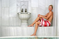 woman relaxing in a hammam bath