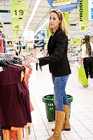 Woman browsing clothes rack