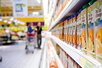 Juice cartons on shelf in supermarket cooler