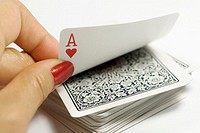 A female hands picking ace from a card stack