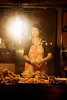 Woman preparing chicken at streetside cafe, Hanoi, Vietnam, Indochina, Southeast Asia, Asia