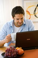 man working at home on notebook