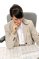 businesswoman reading financial reports