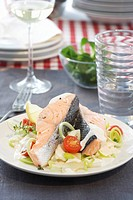 Poached salmon fillet with leeks