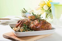 Roast lamb shank with herbs for Easter