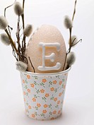 Sugar egg and pussy willow in a beaker