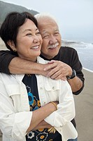 Mature couple embracing at beach
