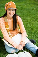 Female student studying outdoors portrait
