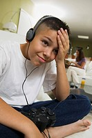 Frustrated Boy with Headphones Playing Video Game