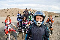 Motocross racers in desert portrait