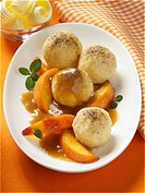 Quark dumplings with peach slices