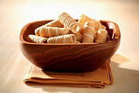 Wafer rolls in wooden bowl