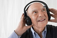 Senior man wearing head phones in studio
