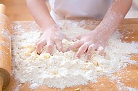 Child´s hands kneading dough
