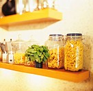 Pasta in storage jars, basil