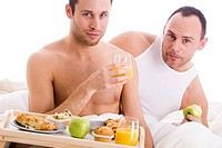 Homo couple enjoy their breakfast